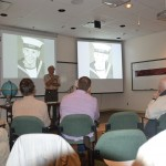 Chris Purton presenting John Galt's personal history.